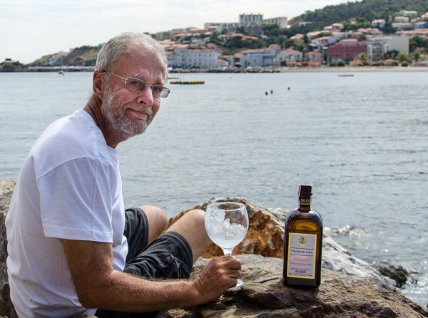 Day 57. Banyuls, 10 September. Drinking a Triple Sec on the rocks to celebrate my third crossing of the Pyrenees, GR10, GR11, and HRP.